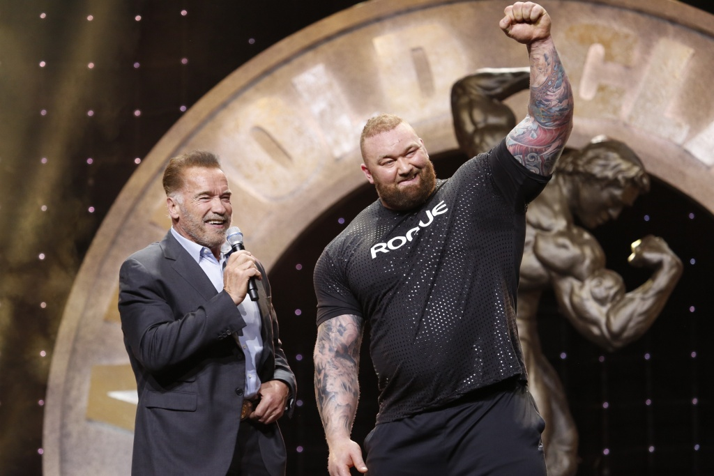 2019 Arnold Strongman Classic Champion Hafthor Bjornsson congratulated by Arnold Schwarzenegger photo by Dave Emery.JPG
